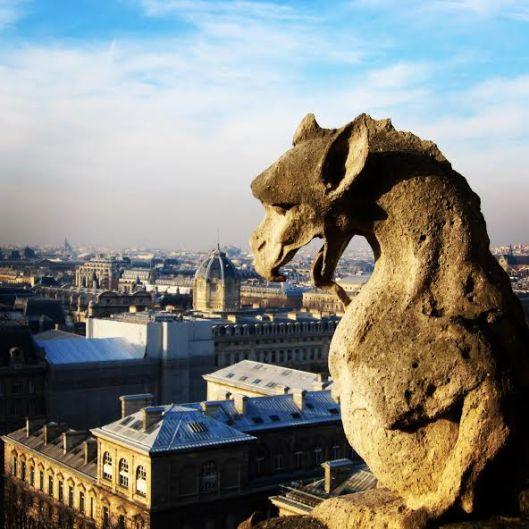 Gargoyle atop Notre Dame Cathedral, Paris, France