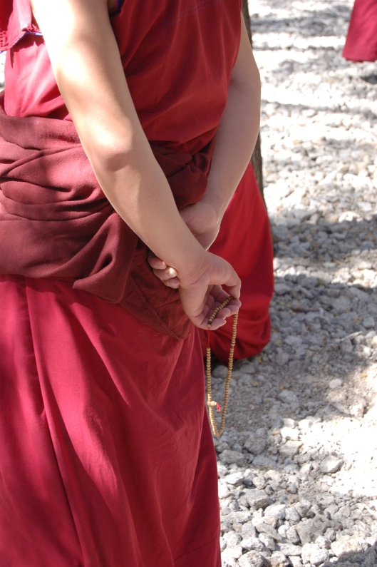 Monk with prayer beads at Sera Monastery, Lhasa, Tibet